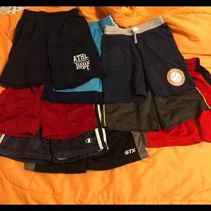 Lot of 8 boys running shorts. Sizes vary